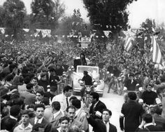 3/3/1959  Surrounded by a motorcycle escort and EOKA fighters wearing arm bands, Archbishop Makarious rides in triumph through Nicosia on Sunday on his return from exile.  It is estimated that over 180,000 Greek Cypriots crowded into Nicosia to greet the Archbishop.