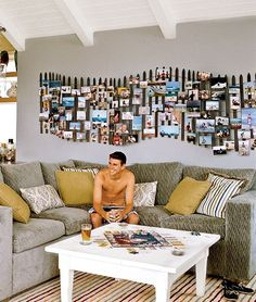Inspired by the weathered fences that you see along sand dunes, the owners of this home constructed a beach fence to display their vacation photos. Featured on BBL: http://beachblissliving.com/vacation-photo-wall-display-idea/