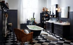 Independent bathroom in black and white tiled bathroom