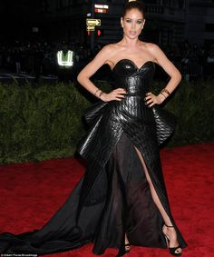 Serious sex appeal: Doutzen Kroes looked sexy in a leather dress with flowing train by Theyskens Theory