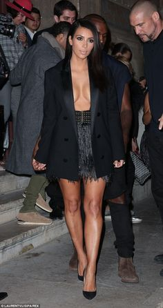 Kim Kardashian-West donned a masculine black tuxedo jacket over a flapper style skirt that ruffled elegantly as she stepped out of the art district apartments in Paris September 2014 Kim Kardashian Bikini, Kardashian Style, Kardashian Jenner, Kourtney Kardashian, Kardashian Fashion, Met Gala Outfits, Black Tuxedo Jacket, Revealing Dresses, Kim K Style