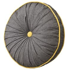 Love this round toss pillow on my yellow sofa!