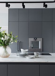 a sleek contemporary graphite grey kitchen with marble countertops and black lights Dark Grey Kitchen, Small American Kitchens, Homemade Furniture, Cheap Furniture, Furniture Websites, Furniture Stores, Inexpensive Furniture, Furniture Nyc, Furniture Removal