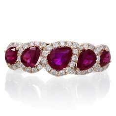 Wedding band, anniversary band, this ruby ring will fit the occasion. A fine 18 karat rose gold, featuring natural exquisite vibrant red pear cut rubies, the birthstone of July. This ruby band can compliment your engagement ring, also celebrate your anniversary, a great gift idea.