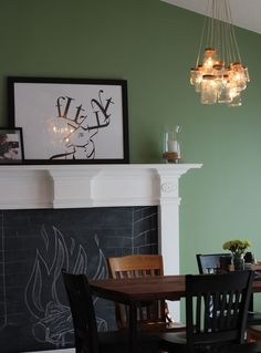 chandelier, but love the covered fireplace with chalk drawing!! cute