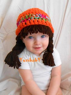 Adorable cabbage patch inspired hat for girls! Wonderful winter hat or Halloween Costume! * Size - Comes in every size * Color - Burnt Orange, Multi color, Chocolate • Handmade with 100% acrylic yarn