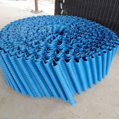 The cooling tower pvc fill roll is made of oblique staggered circle material, and its packing angle is generally 60 ℃ to form honeycomb. Cooling Tower, Water Treatment, Honeycomb, Rolls, Cool Stuff, Outdoor Decor, Cool Things, Bread Rolls, Water Purification