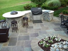 Stone patio & outdoor kitchen.