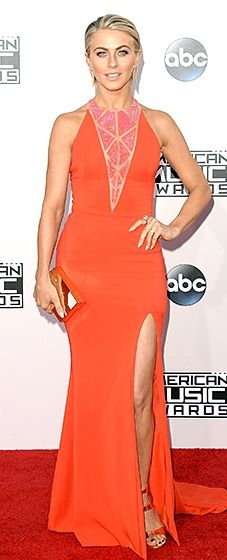 Julianne Hough sizzled in an orange racer back gown with a plunging beaded neckline by Zuhair Murad. A Lee Savage rose gold clutch and Tamara Mellon heels completed the look.