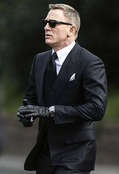 2a7ae230631 Photographs of Daniel Craig as James Bond from Spectre  a suited and ...