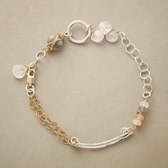 """MOONSTONE MEDLEY BRACELET--Moonstones bejewel an intermingling of sterling silver and 14kt gold filled. A labradorite joins in near the lobster clasp. Exclusive. Handmade in USA. 6-1/2"""" to 7""""L."""