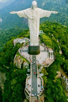 Christ the Redeemer Statue, Rio de Janeiro | Standing 124 feet tall and one of the New Seven Wonders of the World, this iconic symbol of Christianity is a bucket list staple for travelers near and far.