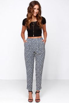 Is your look feeling a little basic? Liven it up with the Jogger Memory Beige and Blue Print Pants! These lightweight woven joggers have an elasticized waistband with a high-waisted fit and relaxed look. Diagonal front pockets, and one back flap pocket top the pant legs that taper to a fitted ankle cut. Lined to mid-thigh. 100% Polyester. Hand Wash Cold. Made With Love in the U.S.A.