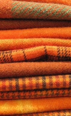 Cozy woll tartan is perfect for fall and winter decorating. Would you use one of these orange patterns as a throw blanket, pillow, curtains even?