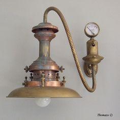 Antique applique with steampunk design, patina copper, and brass. #steampunk #sconce #antique #designlamp #copper