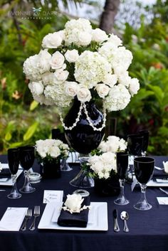 The reverse table setting is stunning - black table cloth, napkins and details with white florals. Repinned by #indianweddingsmag #tablescape #black #white #weddings #couples #bride #groom #brideandgroom #summerweddings #aboutindianweddings indianweddingsmag.com