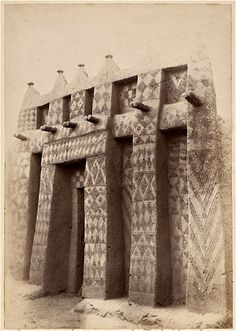 Antique photo taken in Mali at the end of 19th century.  Mud house with a beautifully decorated entrance.  (Mud Architecture in West Africa)