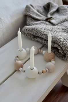 Another version of a candleholder made of wooden beads, inspired by Ferm living