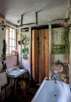 There's no rule that says your bathroom has to be 100% sleek and shiny. If you're a fan of the Bohemian chic look in other parts of the house, why shouldn't it extend to the bathroom as well?