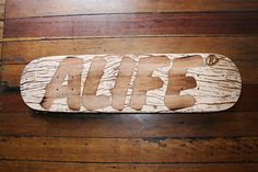 Refill Seven laser-etched skateboard by Alfie