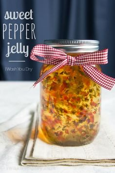 Sweet Pepper Jelly: 3/4 cup finely chopped red bell pepper, 3/4 cup finely chopped green bell pepper, 1 1/2 cup white vinegar, 6 1/2 cups white sugar, 2 packets liquid pectin (6 tablespoons) 3 Pint Sized canning jars - sterilized (or 6-7 Half Pint Sized canning jars)