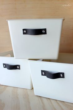 Turn boring dollar store bins into stylish storage by adding simple leather handles!