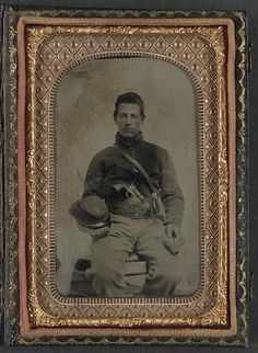 Unidentified soldier in Union uniform with Company F hat and upside down U.S. belt buckle, armed with Colt revolver and cavalry sword. (Library of Congress)