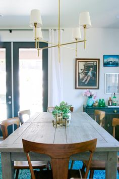Rebecca Zajac overhauled a basic builder's kitchen into a unique, eye-catching space featuring a newly built island, globe pendant lights and a custom tile backsplash.