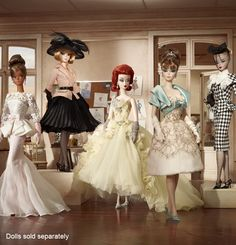 I covet every Barbie in this photo but I will definitely own the redhead in the middle when she's available.