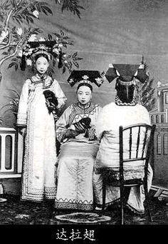 Ladies of the Imperial Court holding Pekingese