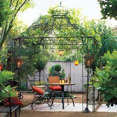 A filigreed wrought-iron gazebo defines the dining space without blocking the sunset, the stars, or the breeze. Similar to shown: Iron Domed Gazebo, about $1,200; Home Garden and Patio Outlet. | Photo: Rob D. Brodman | thisoldhouse.com