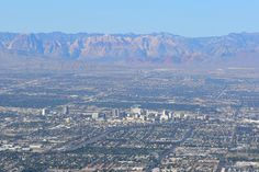 Downtown Las Vegas and Red Rock behind