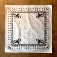 """The MADE SOUTH Home State Kerchief is cut and sewn in South Carolina of natural, undyed cotton. It is hand-screen using water soluble inks in Tennessee. The design is a simple tribute to our home state of Tennessee. 22"""" x 22"""". Black on natural."""