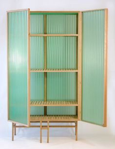 Dik Scheepers - Sine Cabinet, made of oak and translucent corrugated PVC.