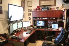 The main system, consisting of the four front-and-center monitors on the desk. Description from inspirationfeed.com. I searched for this on bing.com/images