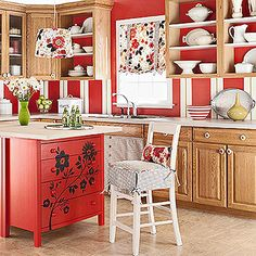Create your own storage-savvy kitchen island by placing two unfinished dressers back-to-back beneath a white-stained solid-core door. Use screws to hold the pieces together and a coat of polyurethane sealer to protect the surface from spills and splatters. For extra pizzazz, add a flower stencil to the drawers.