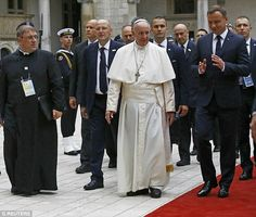 Pope Francis attends a welcoming ceremony with Polish President Andrzej Duda (right) at Wawel Royal Castle