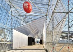 Polycarbonate panels are fitted to scaffolding to create a tubular space within Peris + Toral Arquitectes temporary pavilion for a public square in Barcelona