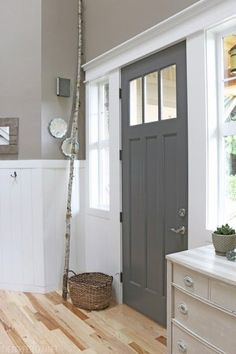 Door: Benjamin Moore Kendall charcoal, walls: Behr All-in-One studio taupe, trim: Benjamin Moore white dove