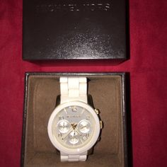 Michael Kors Watch White Michael Kors watch! Only wore a few times, very comfortable and always in style.  Comes with original box and extra links.  A must have! Michael Kors Accessories Watches