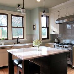 If you ignore the mint green and imagine the grey subway tile going all the way to the ceiling, this would be a great kitchen.