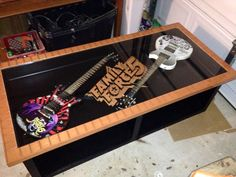 guitar coffee table. the background is broken cd pieces and the