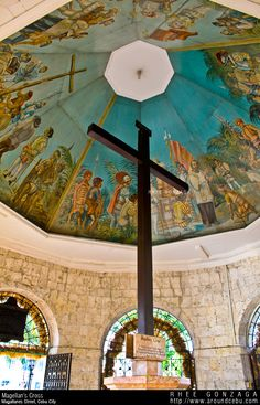 Magellan's Cross, Cebu, Philippines ~ planted by Portuguese, & Spanish explorers as ordered by Ferdinand Magellan upon arriving in Cebu in April of 1521. This cross is housed in a chapel next to Basilica Minore del Santo Niño just in front of the city center of Cebu. A sign below describes the original cross is encased inside the wooden cross for purposes of protection.