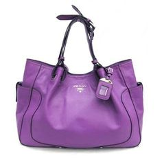"Purse- pretty color.  Need to see the inside and make sure it meets my ""requirements""  lol"