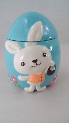 White Easter Bunny w Basket on Big Blue Easter Egg Cookie Jar.