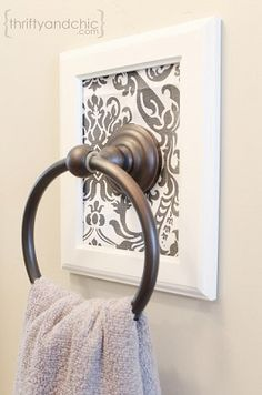 DIY Decorative Framed Towel Holder [Tutorial] : how to make boring towel racks something to talk about! All you need are scissors, fabric, frame, towel holder and Glue Dots - all available at Lowe's. #homedecor #homeimprovement #DIY