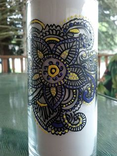 Enjoy this hand painted clear glass candle holder. I designed this with the look of a Henna Tattoo done in black and yellow and purple paint. It is heat set but I do not suggest placing in the dish washer.  It is a good size piece measuring 7 high and 3 1/4  diameter  Candle not included  ...