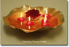 I like this idea for a center piece, with a white or silver shell and pastel colored flower & candles.