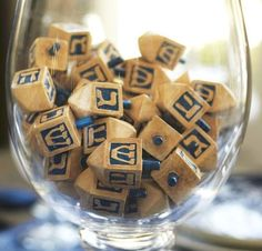 hand-painted dreidels in a glass vase or scattered around your Hanukkah table