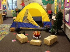 We have a camping day in preschool. I made the fire out of butcher paper and a big bowl, got the hay bales at Walmart for $5, put up my Christmas tree without lights, and got sticks and hot glued cotton balls to the ends. I re-use my hay bales and Christmas tree for many different themes throughout the year. I keep the hay bales in the plastic so they don't shed on my floor.